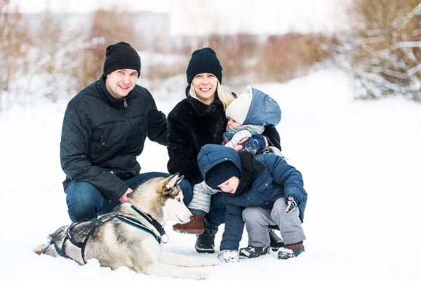 Family With Dog in Snow